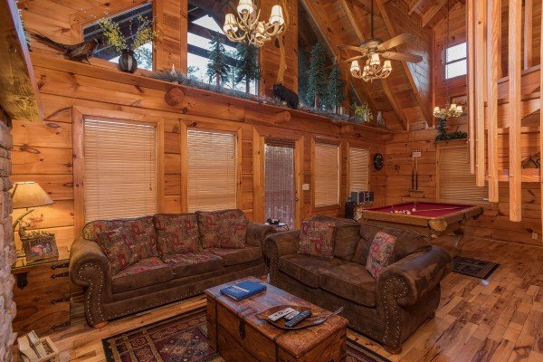 living room sofa and loveseat at always & forever a 1 bedroom cabin rental located in pigeon forge