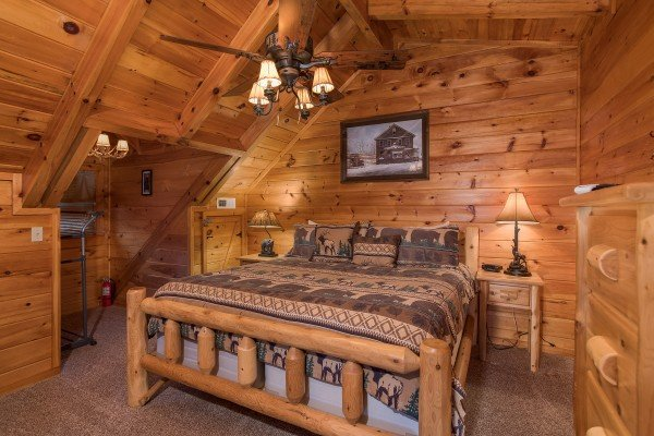 king sized log bed in a loft at always & forever a 1 bedroom cabin rental located in pigeon forge