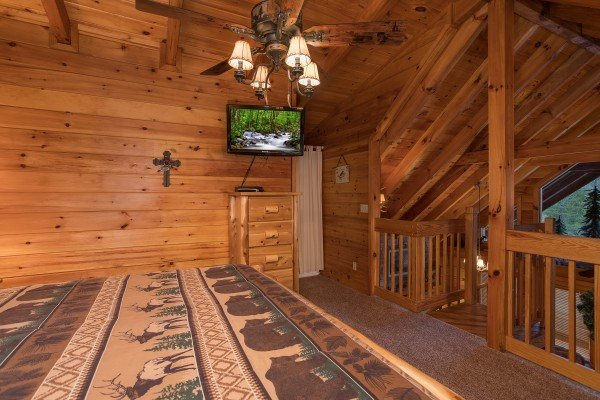 storage and television in the loft bedroom at always & forever a 1 bedroom cabin rental located in pigeon forge