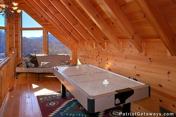 Air hockey table in the loft space at Tennessee Dreamer, a 5 bedroom cabin rental located in Pigeon Forge