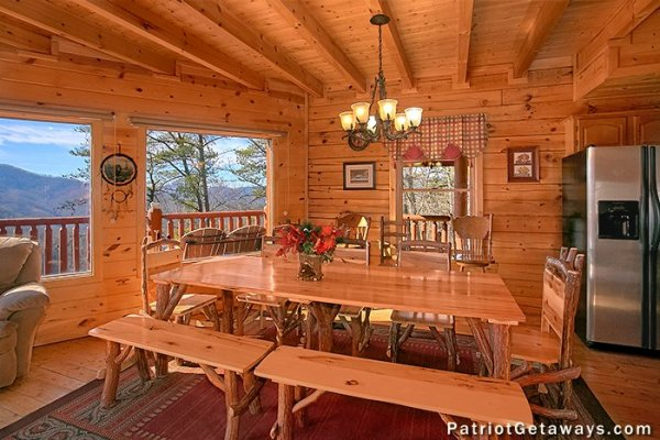 Large dining table at Tennessee Dreamer, a 5 bedroom cabin rental located in Pigeon Forge