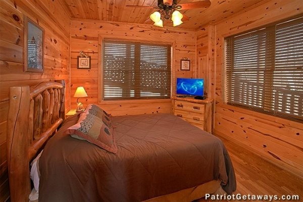 Bedroom with a queen bed, dresser, and TV at Tennessee Dreamer, a 5 bedroom cabin rental located in Pigeon Forge