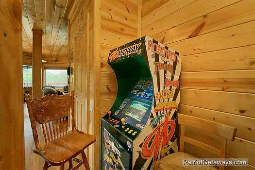 Game area with arcade game at Tennessee Dreamer, a 5 bedroom cabin rental located in Pigeon Forge