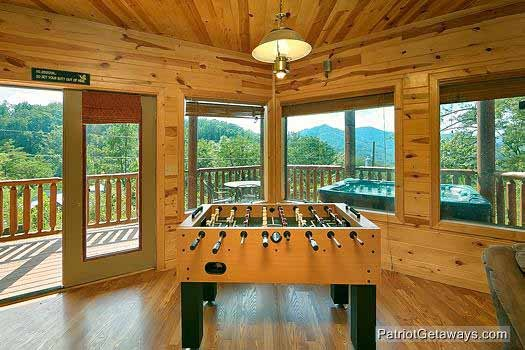 Game area with foosball table at Tennessee Dreamer, a 5 bedroom cabin rental located in Pigeon Forge