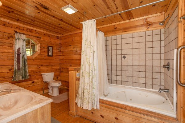 Jacuzzi bathroom at Tennessee Dreamer, a 5 bedroom cabin rental located in Pigeon Forge