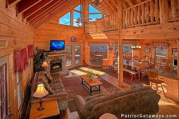 Main floor with living room, dining space, and kitchen at Tennessee Dreamer, a 5 bedroom cabin rental located in Pigeon Forge