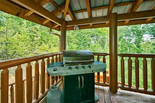 Main level deck with grill at Tennessee Dreamer, a 5 bedroom cabin rental located in Pigeon Forge