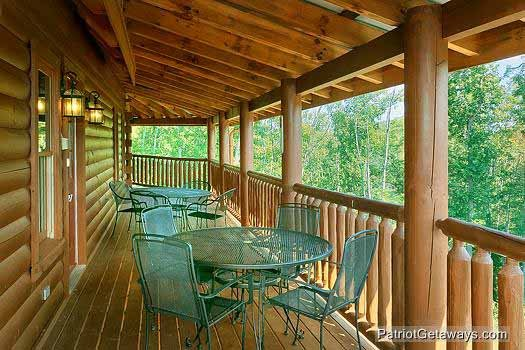 Main level deck with seating at Tennessee Dreamer, a 5 bedroom cabin rental located in Pigeon Forge
