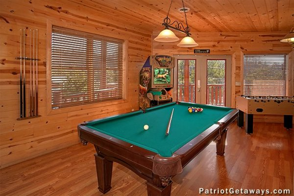 Pool table and foosball on the first floor at Tennessee Dreamer, a 5 bedroom cabin rental located in Pigeon Forge