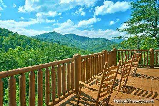 Second floor deck with rockers at Tennessee Dreamer, a 5 bedroom cabin rental located in Pigeon Forge