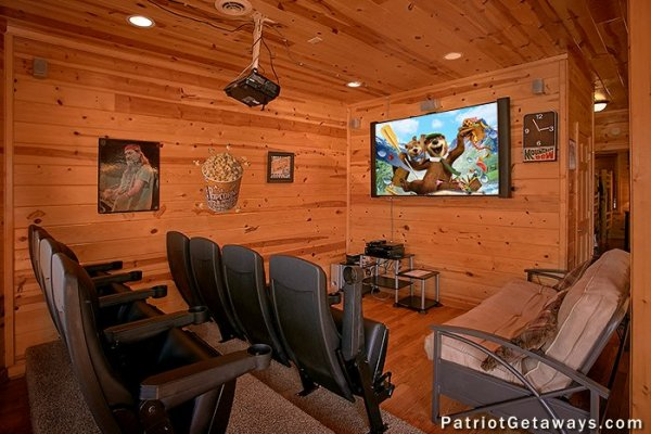 Theater room with lots of seating at Tennessee Dreamer, a 5 bedroom cabin rental located in Pigeon Forge
