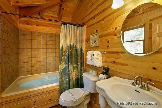 Bathroom with a jacuzzi at Tennessee Dreamer, a 5 bedroom cabin rental located in Pigeon Forge