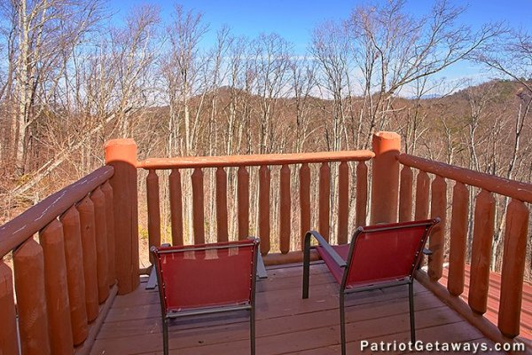 Upper deck with two chairs at Tennessee Dreamer, a 5 bedroom cabin rental located in Pigeon Forge