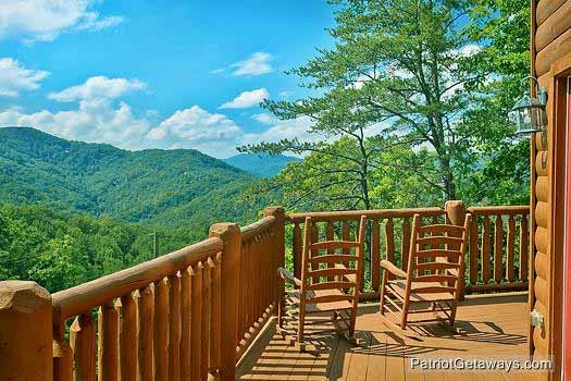 Upper level deck with rockers at Tennessee Dreamer, a 5 bedroom cabin rental located in Pigeon Forge