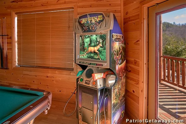 Arcade game at Tennessee Dreamer, a 5 bedroom cabin rental located in Pigeon Forge