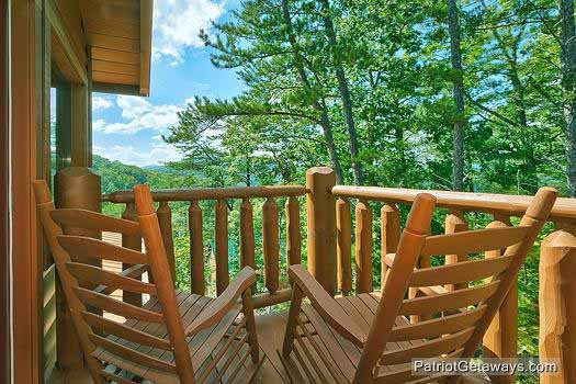View from upper level deck with rockers at Tennessee Dreamer, a 5 bedroom cabin rental located in Pigeon Forge