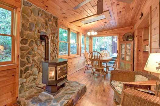 fireplace and dining room at a beautiful river a 1 bedroom cabin rental located in gatlinburg