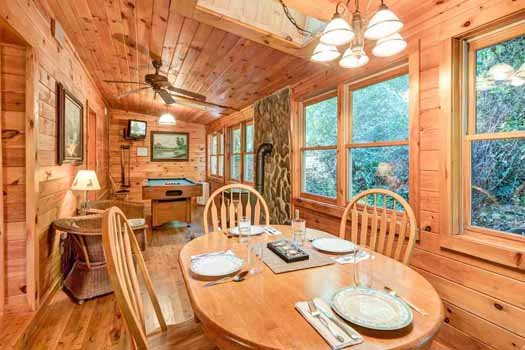dining space with fireplace and pool table at a beautiful river a 1 bedroom cabin rental located in gatlinburg