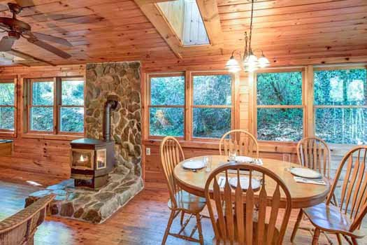 dining room and fireplace at a beautiful river a 1 bedroom cabin rental located in gatlinburg