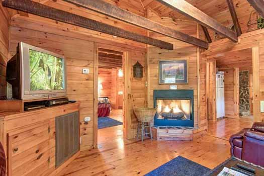 fireplace and television at a beautiful river a 1 bedroom cabin rental located in gatlinburg