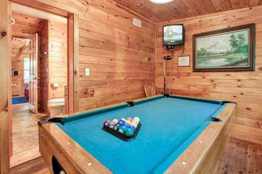 pool table and small television at a beautiful river a 1 bedroom cabin rental located in gatlinburg