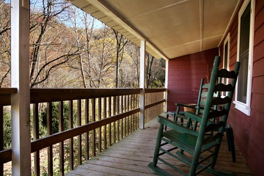 rocking chairs on the deck at a beautiful river a 1 bedroom cabin rental located in gatlinburg