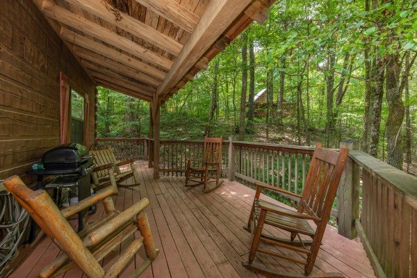 Rocking chairs on a covered deck at Cabin on the Mountain, a 2 bedroom cabin rental located in Gatlinburg