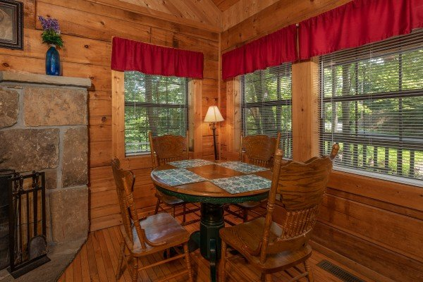 Dining table for four in the living room at Cabin on the Mountain, a 2 bedroom cabin rental located in Gatlinburg