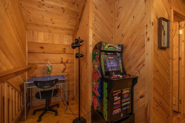 Arcade game and desk in the loft at Cabin on the Mountain, a 2 bedroom cabin rental located in Gatlinburg