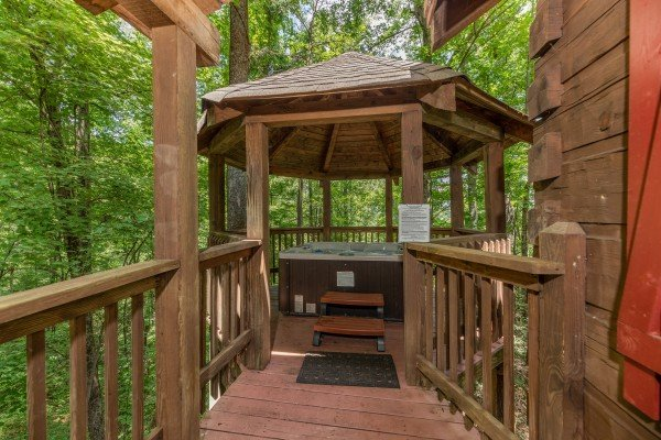 Hot tub in a gazebo on the deck at Cabin on the Mountain, a 2 bedroom cabin rental located in Gatlinburg