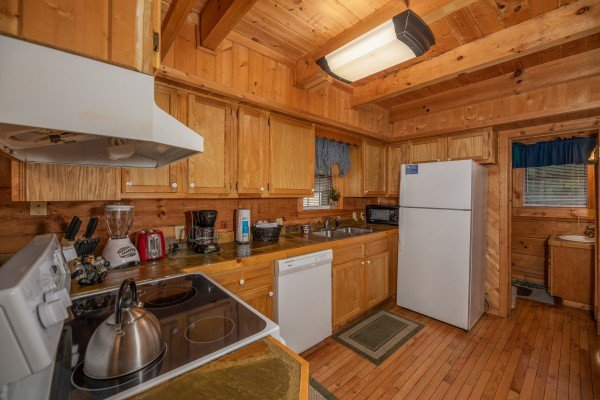Kitchen with white appliances at Cabin on the Mountain, a 2 bedroom cabin rental located in Gatlinburg