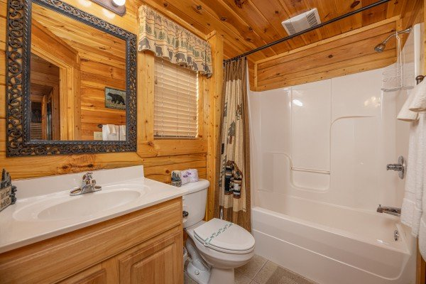 Bathroom with a tub and shower at An Elegant Moose, a 2 bedroom cabin rental located in Pigeon Forge