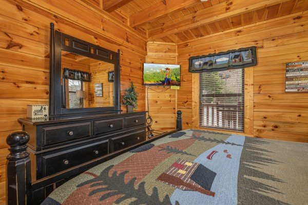 Dresser and TV in a bedroom at An Elegant Moose, a 2 bedroom cabin rental located in Pigeon Forge
