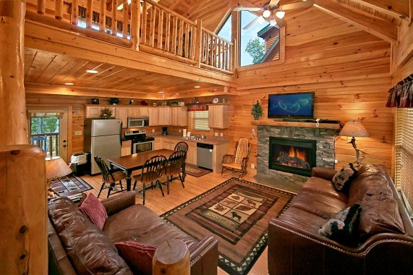 living room with loft overhead at an elegant moose a 2 bedroom cabin rental located in pigeon forge