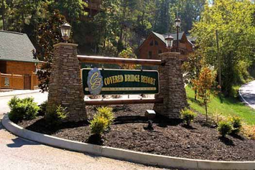 resort signage and landscaped entrance for an elegant moose a 2 bedroom cabin rental located in pigeon forge