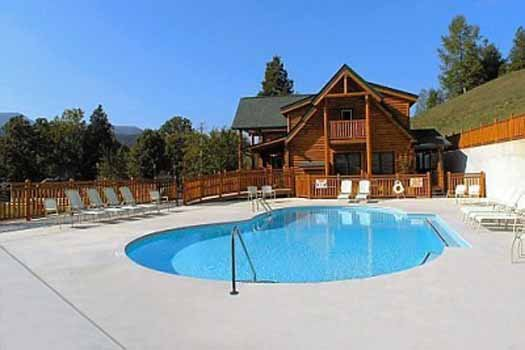 swim in the resort pool at an elegant moose a 2 bedroom cabin rental located in pigeon forge