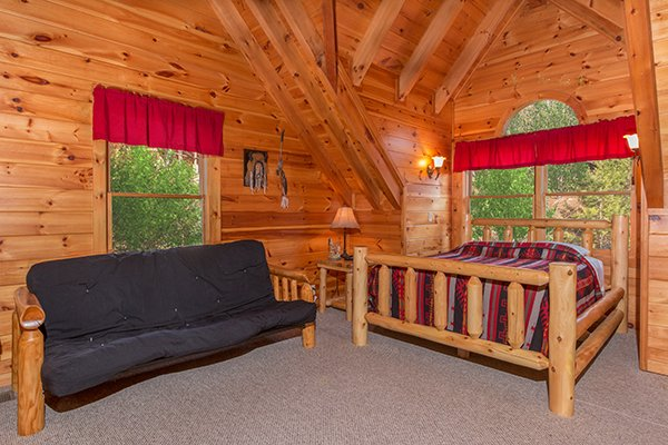 bedroom in the loft with futon and queen bed at alpine sondance a 2 bedroom cabin rental located in pigeon forge