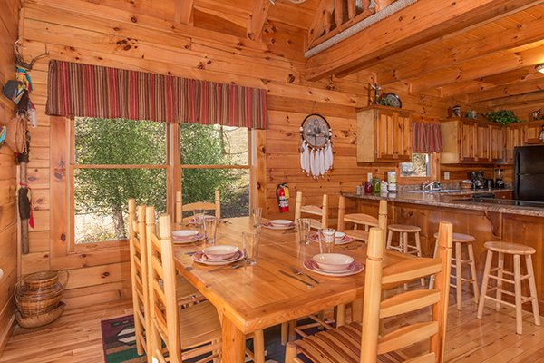 dining table with seating for six and four counter top seats at alpine sondance a 2 bedroom cabin rental located in pigeon forge