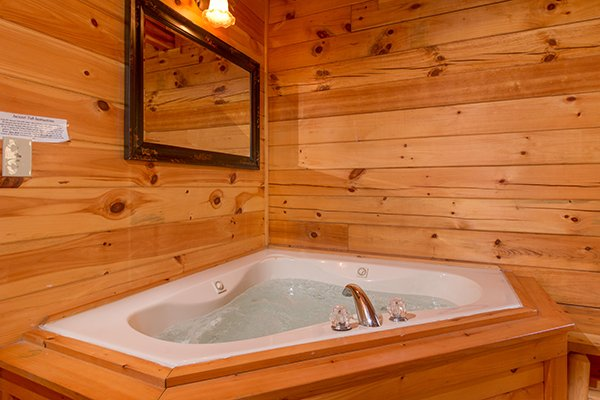 jacuzzi in king bedroom at alpine sondance a 2 bedroom cabin rental located in pigeon forge