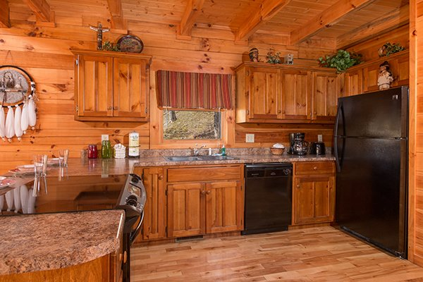 kitchen with black appliances at alpine sondance a 2 bedroom cabin rental located in pigeon forge