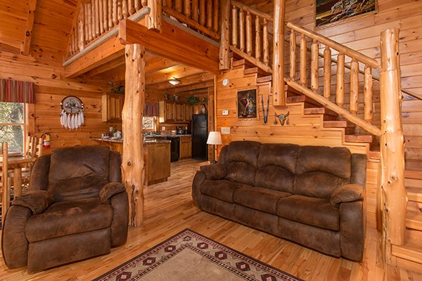 a brown recliner and sofa in the living room at alpine sondance a 2 bedroom cabin rental located in pigeon forge