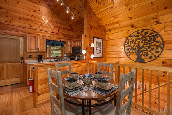 Dining table for four at Kelly's Cabin, a 1 bedroom cabin rental located in Pigeon Forge