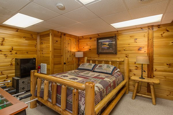 Bedroom on the lower floor at Kelly's Cabin, a 1 bedroom cabin rental located in Pigeon Forge