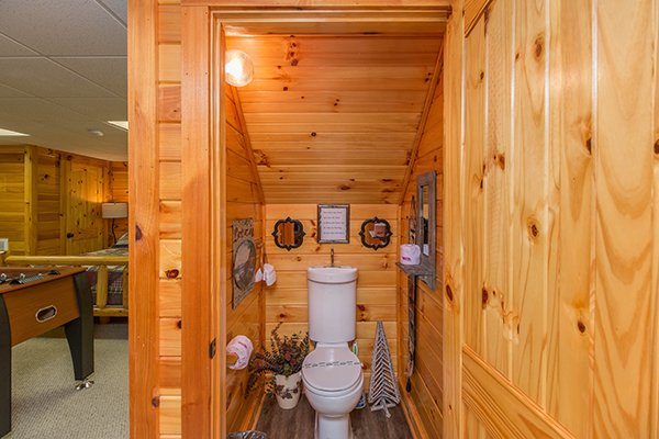 Half bath on the lower floor at Kelly's Cabin, a 1 bedroom cabin rental located in Pigeon Forge