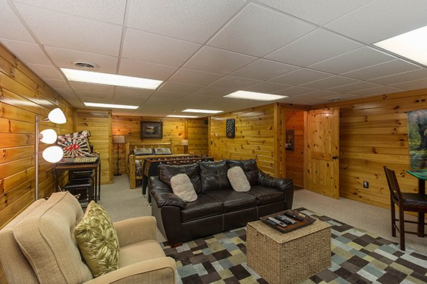 Sitting area on the lower floor at Kelly's Cabin, a 1 bedroom cabin rental located in Pigeon Forge