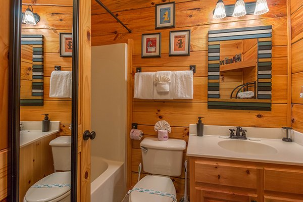 Bathroom with a tub and shower at Kelly's Cabin, a 1 bedroom cabin rental located in Pigeon Forge