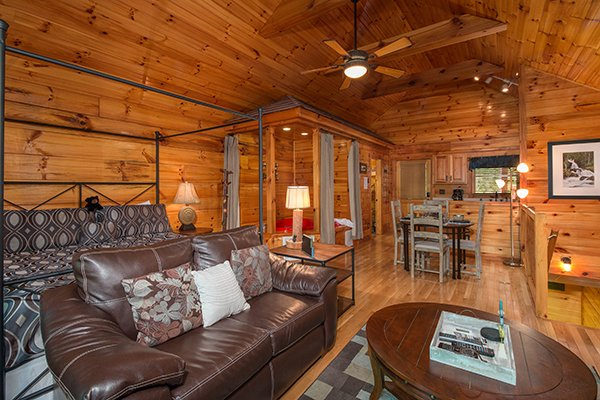 Main floor open concept with living, dining, kitchen, and a bedroom at Kelly's Cabin, a 1 bedroom cabin rental located in Pigeon Forge