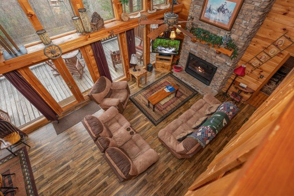 Looking down at the living room at True Grit, a 5 bedroom cabin rental located in Pigeon Forge