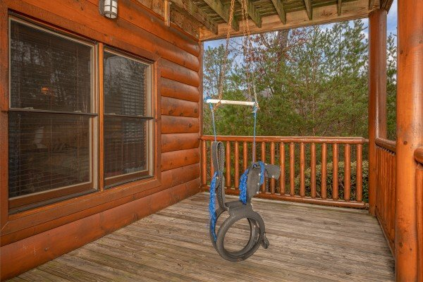 Cowboy swing at True Grit, a 5 bedroom cabin rental located in Pigeon Forge