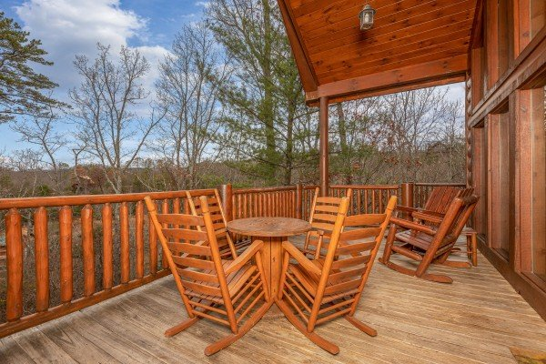 Rocking chairs and dining table on the deck at True Grit, a 5 bedroom cabin rental